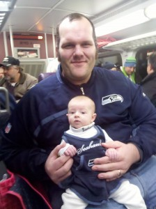 Infant on a train after a football game.